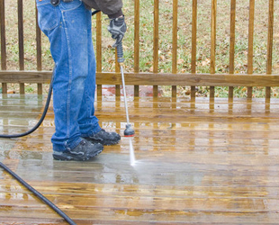 Power Washing a wooden deck in back garden